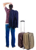 Young expert traveling with suitcase looks ahead. — Foto de Stock