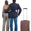 Stock Photo: Young couple traveling with suitcase