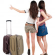 Two young women friends traveling with suitcas and showing thumbs up — Stock Photo #39356457