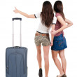 Two young women friends traveling with suitcas and showing thumbs up — Stock Photo #39356479