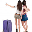 Two young women friends traveling with suitcase and showing thumbs up — Stock Photo #39356515