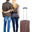 Back view of young couple traveling with suitcase. — Stockfoto #39359405