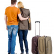 Back view of young couple traveling with suitcase . — Stockfoto #39359453