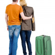 Back view of young couple traveling with suitcase . — Stockfoto #39359465