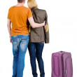 Back view of young couple traveling with suitcase . — Stockfoto #39359473
