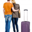Back view of young couple traveling with suitcase . — Stockfoto #39359491