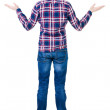 Back view of angry young man in jeans and checkered shirt — Stock Photo