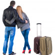 Back view of young couple traveling with suitcase. — Stockfoto #39359821