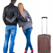 Back view of young couple traveling with suitcase. — Stockfoto #39359823