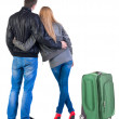 Back view of young couple traveling with suitcase. — Stockfoto #39359861