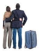 Young couple traveling with suitcase — Stock Photo