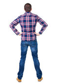 Back view of handsome man in checkered shirt looking up. — Stock Photo