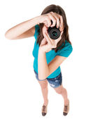 Young woman in shorts photographed something compact camera. — Stock Photo