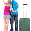 Back view of young couple traveling with suitcase. — Stockfoto #39360387