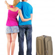 Back view of young couple traveling with suitcase. — Stockfoto #39360389