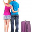 Back view of young couple traveling with suitcase. — Stockfoto #39360403