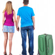Back view of young couple traveling with suitcase. — Stockfoto #39360419