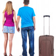 Back view of young couple traveling with suitcase. — Stockfoto #39360437