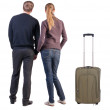 Back view of young couple traveling with suitcase. — Stockfoto #39360717