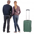 Back view of young couple traveling with suitcase. — Stockfoto #39360721