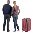 Back view of young couple traveling with suitcase. — Stockfoto #39360737