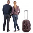 Back view of young couple traveling with suitcase. — Stockfoto #39360757