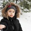 Little girl and snowflakes — Stock Photo