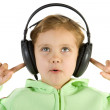 Surprised girl listening music — Stock Photo #2389107