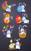 Conejos de pascua con huevos de pascua — Vector de stock