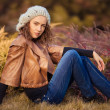 Girl in autumn park — Stock Photo #13554976