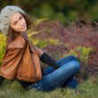 Girl in autumn park — Stock Photo #14472749