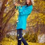 Girl in autumn park — Stock Photo #14472755
