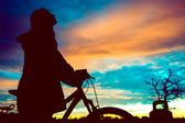 Girl at sunset — Stock Photo
