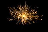 Burning christmas sparkler — Stock Photo