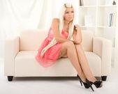 Girl sitting on the sofa — Stock Photo