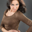 Beautiful woman in a brown dress - Stock Photo