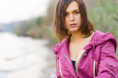 Woman in a pink jacket — Stock Photo