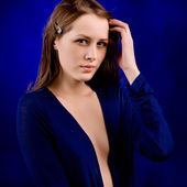 Sexy woman on a blue background — Stock Photo