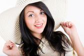 Young woman in a beach hat — Stock Photo