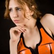 Girl in orange latex suit - Stock Photo