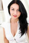 Beautiful woman in a white blouse — Stock Photo