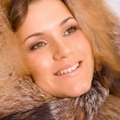 Beautiful young woman in a fox hat — Stock Photo #21656047