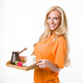 Blonde in an orange shirt with a coffee Split — Stock Photo