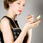 Beautiful glamorous woman in a black dress — Stock Photo #22036133