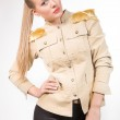 Beautiful girl in a jacket with epaulettes. — Stock Photo #23165360
