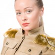 Beautiful girl in a jacket with epaulettes. — Stock Photo #23165374
