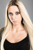 Attractive blonde in a black blouse — Stock Photo