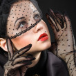 Beautiful woman in a black veil — ストック写真