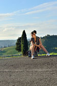 Hitchhiker young girl — Stock Photo