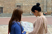 Two girls with map — Stock Photo